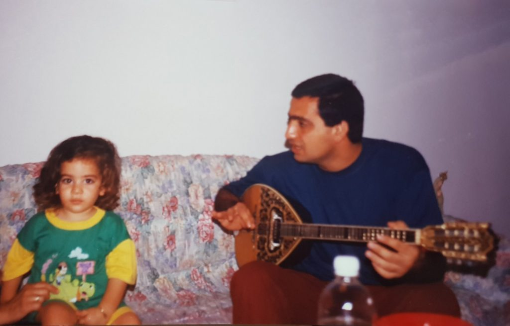 Yossi Aharon at the age of 3, taking a music lessons from the musician George Bar